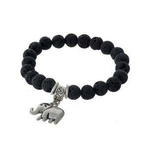 Black lava beaded stretch bracelet with a silver tone elephant charm.