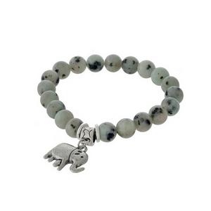 Kiwi natural stone beaded stretch bracelet with a silver tone elephant charm.