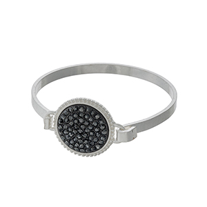 Silver tone bangle with hematite rhinestones in a circle focal.