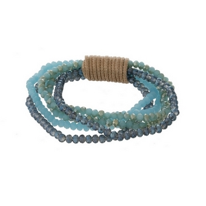 Multi strand beaded stretch bracelet with blue, turquoise and mint faceted beads.