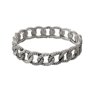 Silver tone stretch bracelet with clear rhinestone accents.