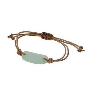 Adjustable brown cord bracelet with a mint green stone.