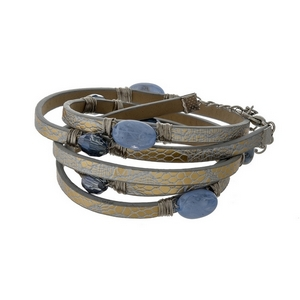 Gray faux leather wrap bracelet with blue stones and a lobster clasp closure.