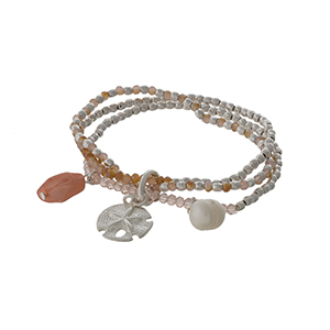 Silver tone and pale pink beaded stretch bracelet with a sand dollar charm.