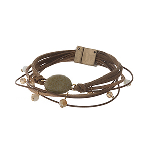Brown cord bracelet with neutral colored stones and a magnetic closure.