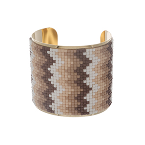 "Gold tone cuff bracelet with white, taupe, and peach beads. Approximately 2.5"" in width."