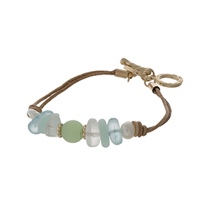 Brown cord toggle bracelet with mint green sea glass stones and gold tone accents.