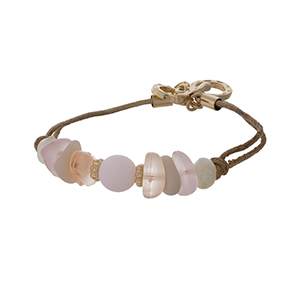 Brown cord toggle bracelet with pink sea glass stones and gold tone accents.