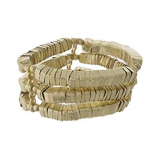 Gold tone, three row stretch bracelet.