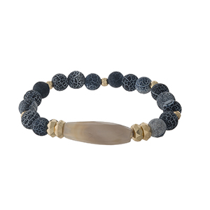 Black beaded stretch bracelet with gold tone beaded accents.