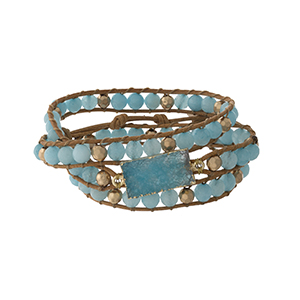 Light blue beaded wrap bracelet with a druzy stone focal and a button closure.