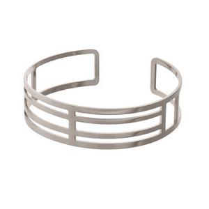Dainty silver tone, cut out cuff bracelet.
