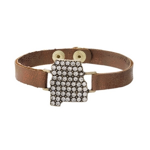 Bronze faux leather snap bracelet with the state shape of Alabama, accented by clear rhinestones.