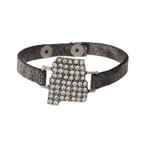 Gunmetal gray, faux leather snap bracelet with the state shape of Alabama, accented by clear rhinestones.