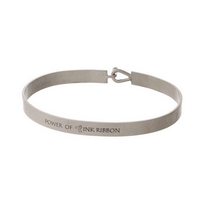 """Silver tone, brass bangle bracelet stamped with """"Power of Pink Ribbon."""""""