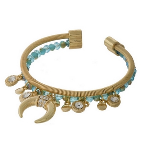 Gold tone and turquoise beaded cuff bracelet with a crescent charm and clear rhinestone accents.