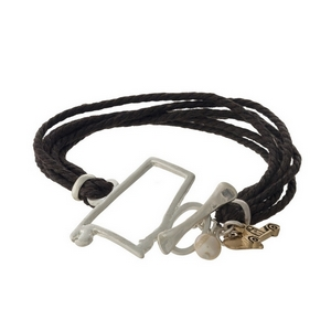 Brown braided cord bracelet with a silver tone shape of Alabama focal, gold tone charms, and a toggle closure.