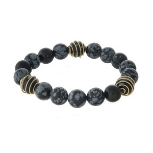 Black and gray, natural stone beaded stretch bracelet with gold tone wire accents.