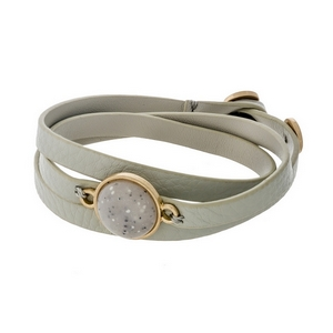 Gray, genuine leather, wrap bracelet displaying a gray, natural stone focal and button closure.