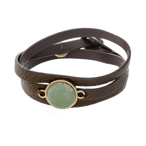 Brown, genuine leather, wrap bracelet displaying a mint green, natural stone focal and button closure.
