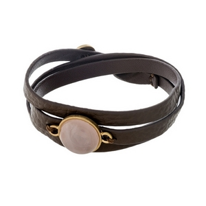 Brown, genuine leather, wrap bracelet displaying a rose quartz, natural stone focal and button closure.