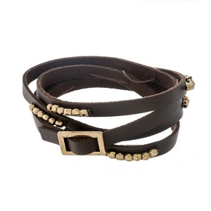 Brown faux leather wrap bracelet featuring gold tone beads.
