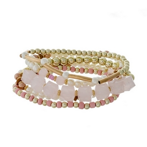 Gold tone stretch bracelet set featuring pale pink, pearl and gold tone beads.