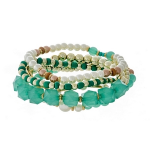 Gold tone stretch bracelet set featuring teal, pearl and gold tone beads.