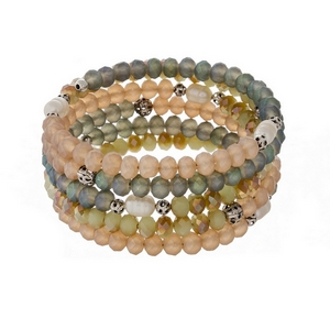 Peach, turquoise and mint green beaded coil bracelet with silver tone accents.