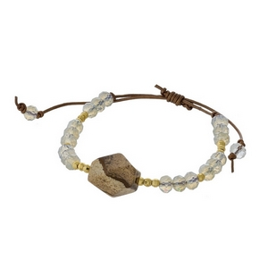 Opal and gold tone beaded pull-tie bracelet featuring a natural stone focal. Handmade in the USA.