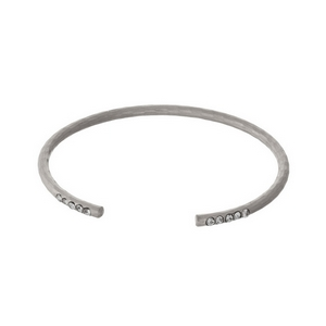 Hammered silver tone cuff bracelet with clear rhinestone accents.