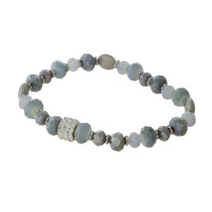 Gray and opal beaded stretch bracelet with silver tone accents.