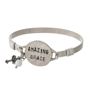 """Silver tone bangle bracelet with a circle focal stamped with """"Amazing Grace."""""""