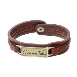 "Officially licensed, University of Alabama brown faux leather snap bracelet with a silver tone bar saying ""Crimson Tide."""