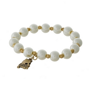 Gold tone and pearl beaded stretch bracelet with a state of Alabama charm.