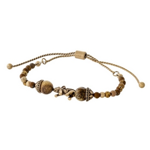 Picture jasper beaded pull-tie bracelet with a gold tone elephant focal.