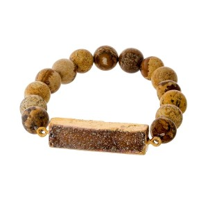 Picture jasper beaded stretch bracelet with a topaz, rectangle druzy stone focal and gold tone accents.