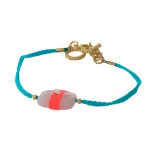 Turquoise braided cord toggle bracelet with a rose quartz stone focal and gold tone accents.