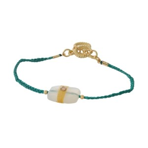 Green braided cord toggle bracelet with a white stone focal and gold tone accents.
