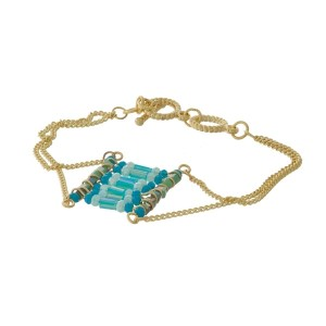 Gold tone toggle bracelet with a turquoise beaded square focal.
