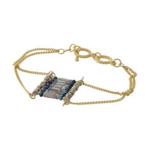 Gold tone toggle bracelet with a gray beaded square focal.
