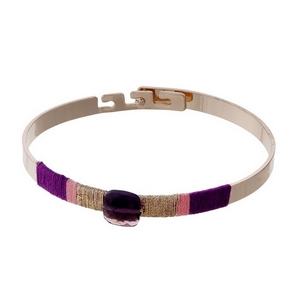 Rose gold tone bangle bracelet with pink and purple thread wrapping details.