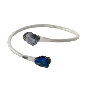 Silver tone cuff bracelet with blue and gray crystal stones on the ends.