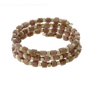 Mauve square natural stone and gold tone beaded coil bracelet.