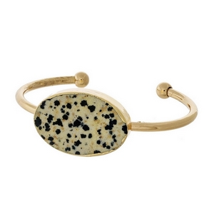 Gold tone cuff bracelet with a dalmatian jasper natural stone focal.