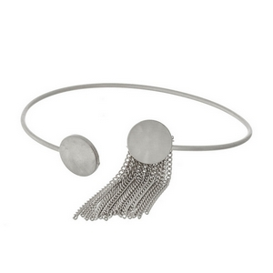 Dainty silver tone cuff bracelet with a chain tassel accent.