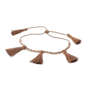 Dainty rose gold tone pull-tie bracelet with rose gold thread tassels.