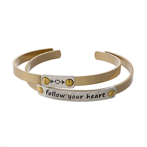 "Two tone, two piece cuff bracelet set stamped with ""Follow Your Heart."""