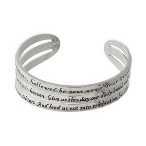 Silver tone cuff bracelet stamped with The Lord's Prayer.