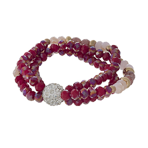 Red beaded stretch bracelet with gold tone accents and a clear rhinestone pave bead.